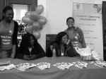 Committee members at the Info table. Do you spot any familiar faces?